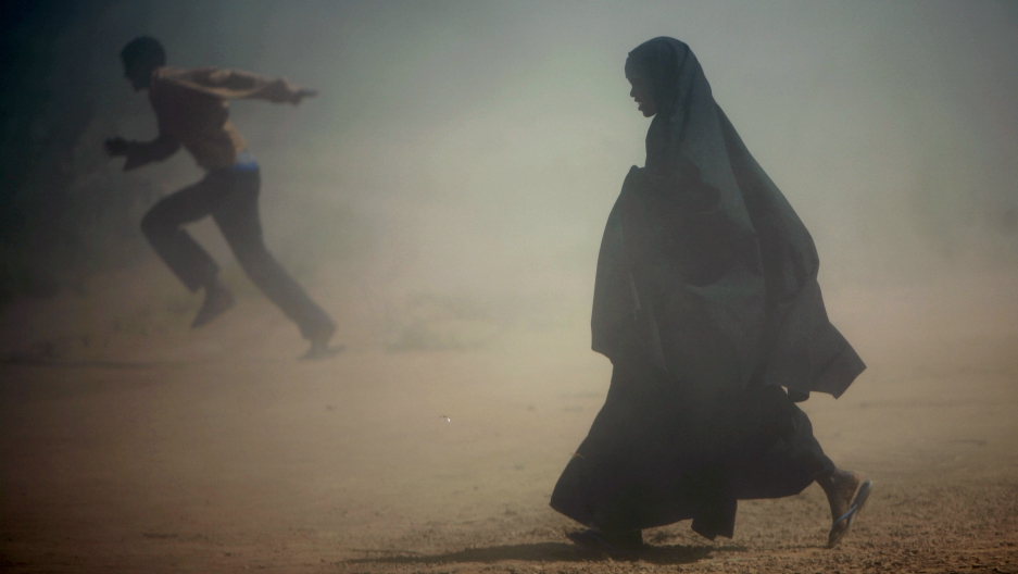 Somali refugees run from the dust at Dadaab's Ifo camp, Jan. 8, 2007.