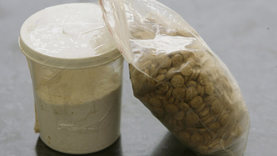 Captagon pills are displayed along with a cup of cocaine at an office of the Lebanese Internal Security Forces (ISF), Anti-Narcotics Division in Beirut on June 11, 2010.