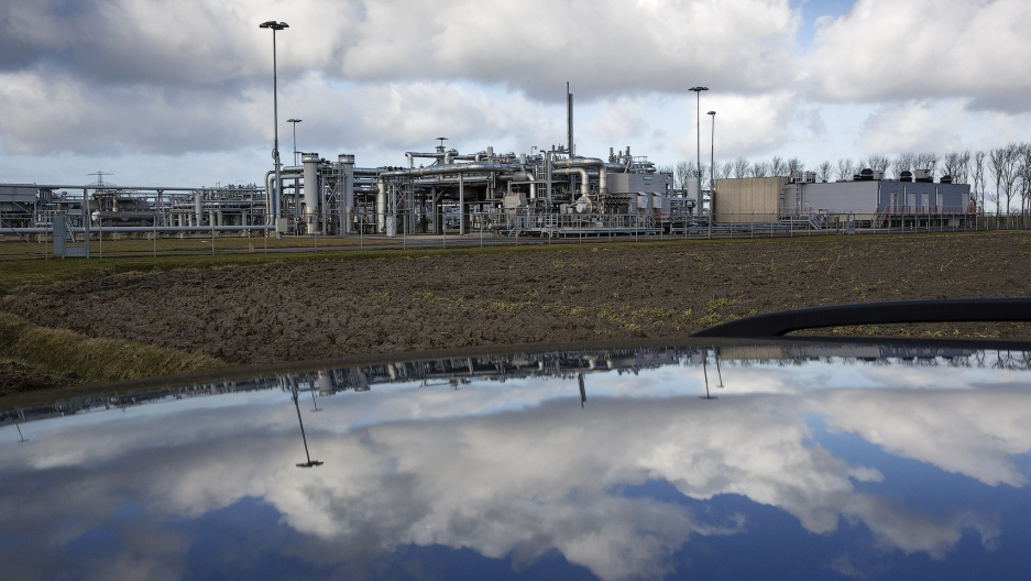 A view of a gas production plant is reflected in the roof of a car in 't Zand in Groningen February 24, 2015