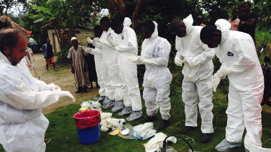 Volunteers prepare to remove the bodies of people who were suspected of contracting Ebola and died in the community in the village of Pendebu, north of Kenema July 18, 2014.