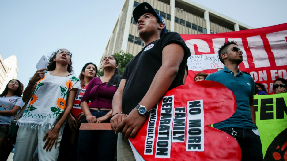 Axel, 15, the son of a Deferred Action for Childhood Arrivals (DACA) program recipient, stands with supporters during a rally outside the Federal Building in Los Angeles, California, U.S., September 1, 2017.