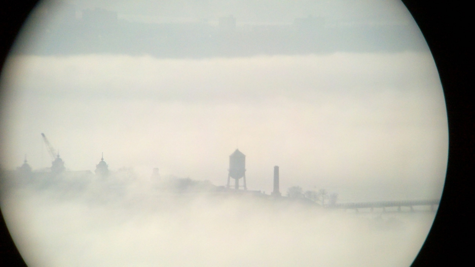 Ellis Island — which once welcomed millions of immigrants to the US — is pictured here shrouded in fog.