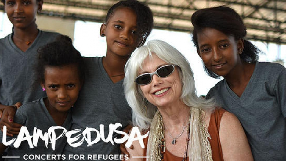 Emmylou Harris is pictured with Eritrean refugees.
