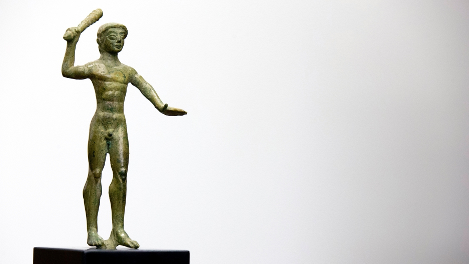 An ancient Etruscan bronze statuette of Herakles dating from the 6th or 5th Century B.C.