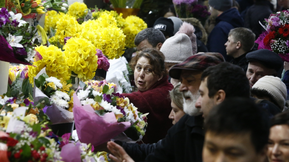A vendor sells flowers for the upcoming International Women's Day at the Rizhsky flower market in Moscow, Russia March 7, 2017.
