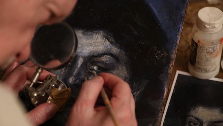 """Mark Landis at work on a """"Picasso."""""""