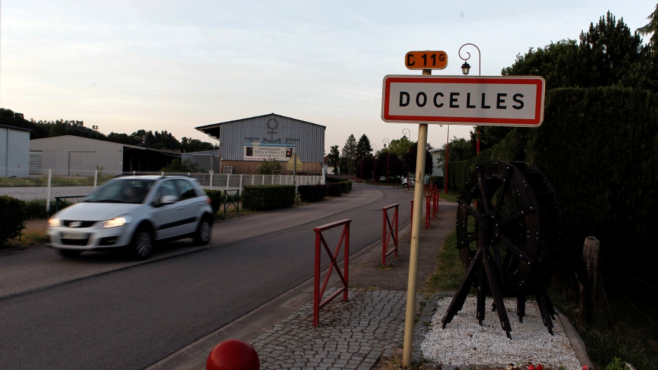 A car drives past the city entrance sign in Docelles, France, June 16, 2017.