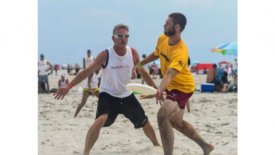 Patrick van der Valk (l) playing at Wildwood Tournament - The World's Largest Beach Ultimate Tournament