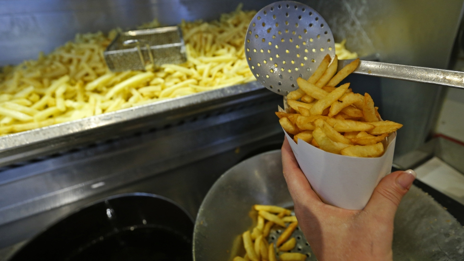 Carine Willaert prepares fries in the Maison Antoine frites stand