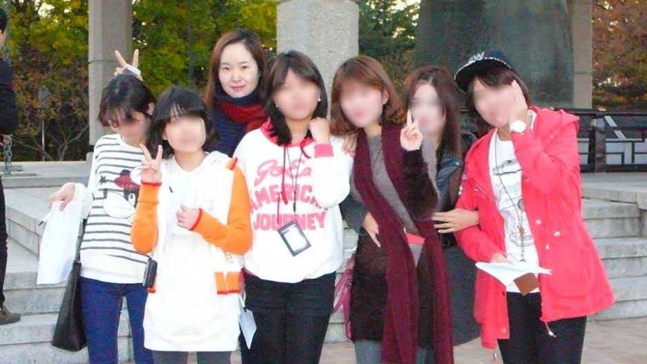 Students from the Daum School on a field trip with their teacher. Their faces are blurred to protect their privacy. Many North Korean refugees have trouble adjusting to life in fast-paced South Korea, especially at school.