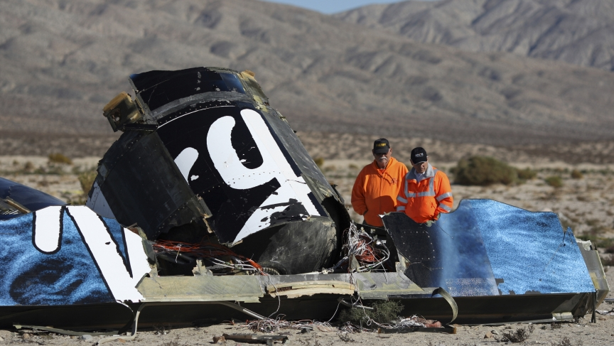 Sheriffs' deputies look at wreckage from the crash of Virgin Galactic's SpaceShipTwo near Cantil, California November 2, 2014. A suborbital passenger spaceship being developed by Richard Branson's Virgin Galactic company crashed during a test flight on Fr