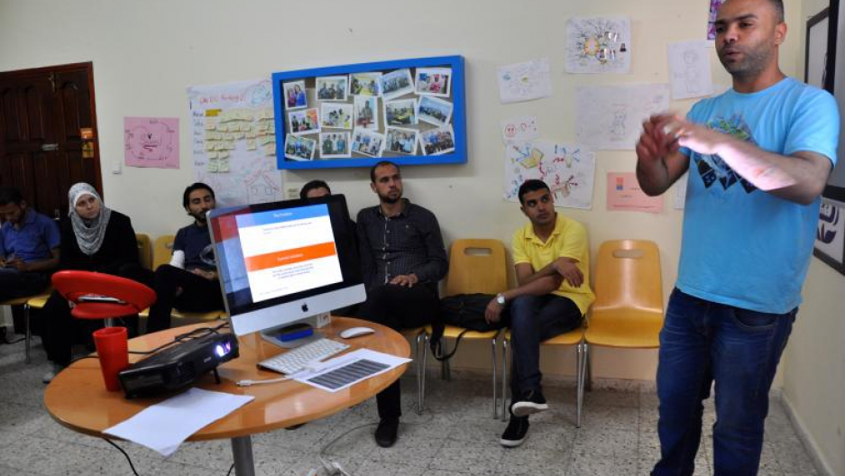 "Said Hassan, manager of Gaza Sky Geeks, advises entrepreneurs at the group's pre-investment ""boot camp."""