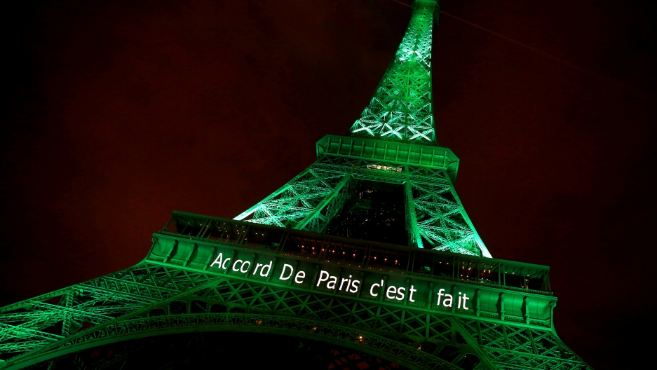 "The Eiffel tower is illuminated in green with the words ""Paris Agreement is Done"", to celebrate the Paris U.N. COP21 Climate Change agreement in Paris, France, November 4, 2016."