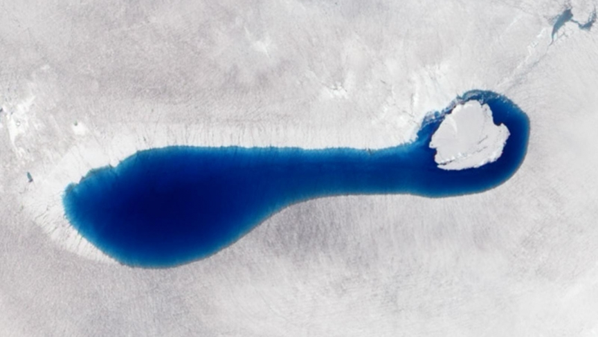 This natural-color image taken on July 4, 2010, by the Advanced Land Imager on NASA's Earth Observing-1 (EO-1) satellite, shows a sapphire-colored pond springing up as snow and ice melt atop the glaciers in southwestern Greenland.