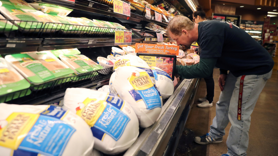 A customer shops for Thanksgiving ham at a grocery store in Los Angeles, California, Nov. 21, 2017.