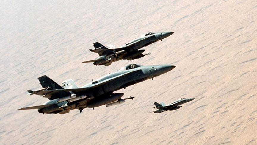 "Three U.S. Navy McDonnell Douglas F/A-18C Hornet fighters from strike fighter squadron VFA-83 Rampagers fly in formation over the desert during ""Operation Desert Storm"" on 3 February 1991."