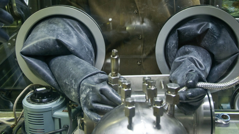 A worker at the Savannah River Site in South Carolina uses a glovebox to handle hazardous materials. The Savannah River Site is one of the locations the Trump administration is considering to host a ramp-up in nuclear warhead production.