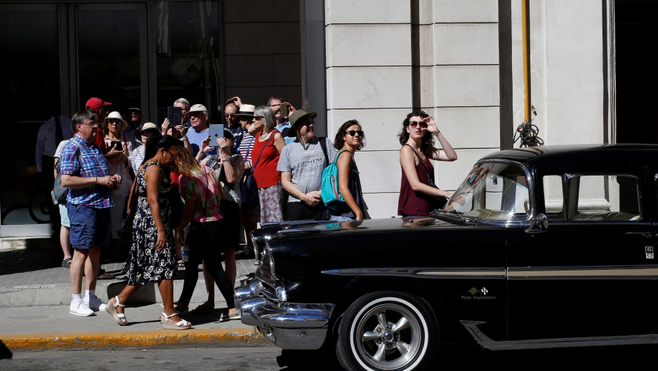 Tourists walk in Havana, Cuba, Nov. 8, 2017.