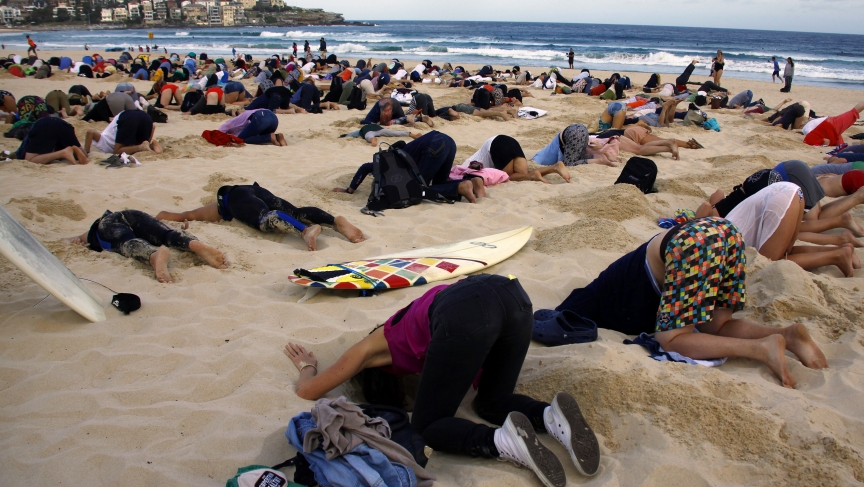 Protesters with their heads in the sand