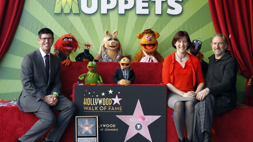 Rich Ross, Lisa Henson, CEO of The Jim Henson Company, and her brother Brian Henson and the muppets