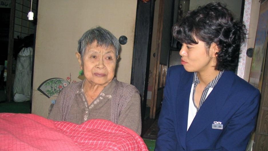 Social worker Minori Nakaso pays a home visit to an atomic bomb survivor in Hiroshima.