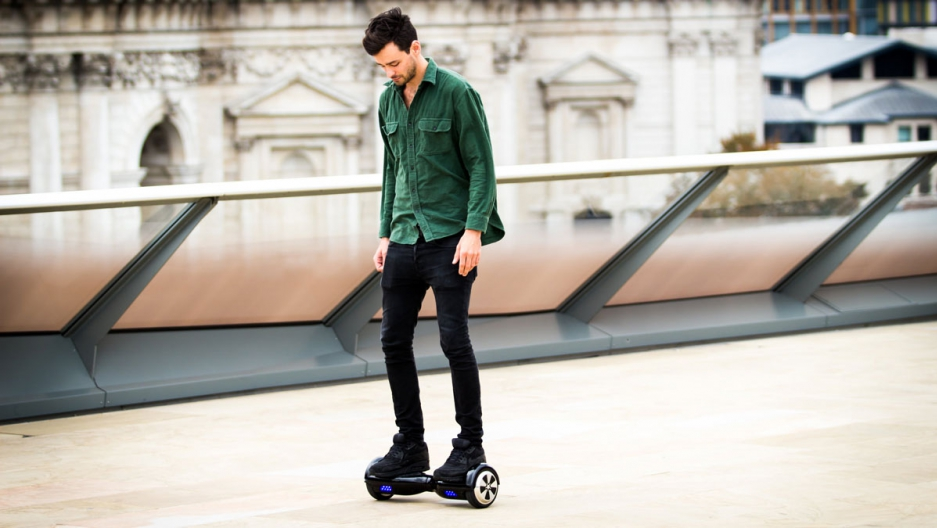 A man rides a hoverboard.