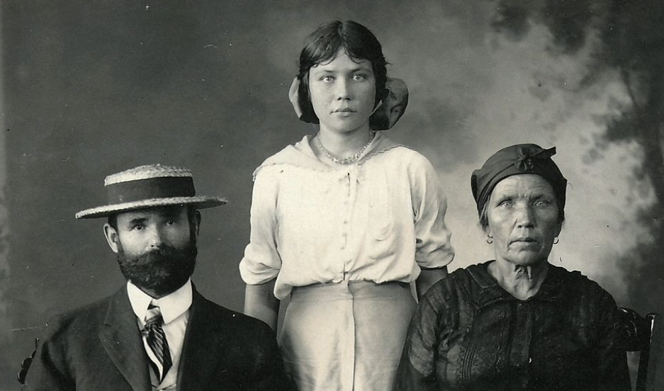 A Russian family migrating to Hawaii pose for a passport photo.