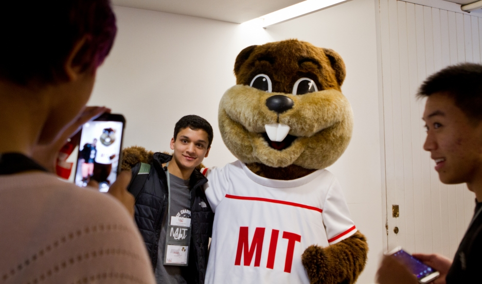 Admitted MIT students pose with the school's mascot during a weekend of activities at the university.