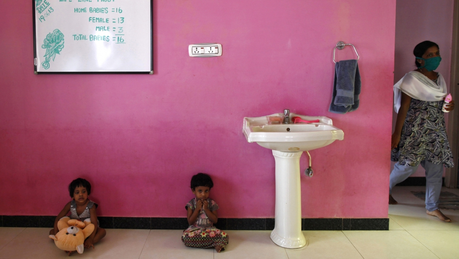 Girls sit inside the Life Line Trust orphanage in Salem in the southern Indian state of Tamil Nadu on June 20, 2013.