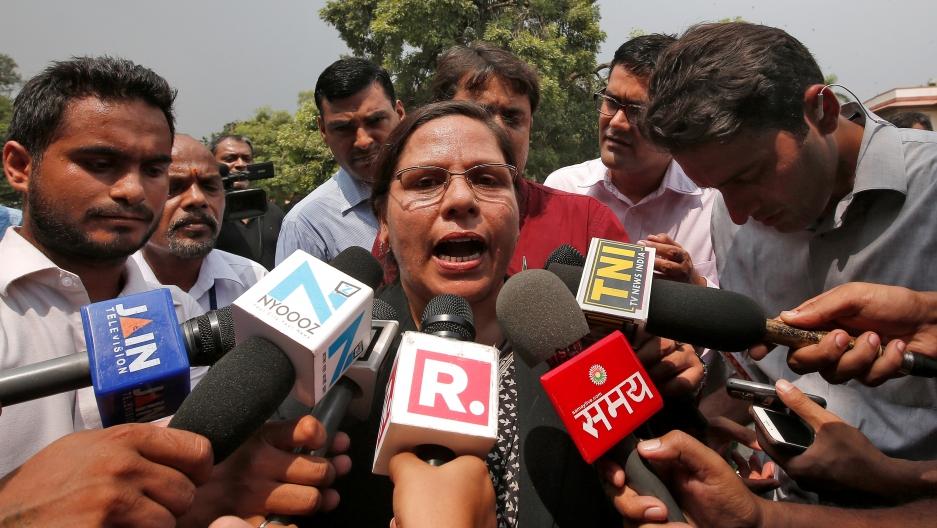 Farha Faiz, a lawyer, speaks with the media