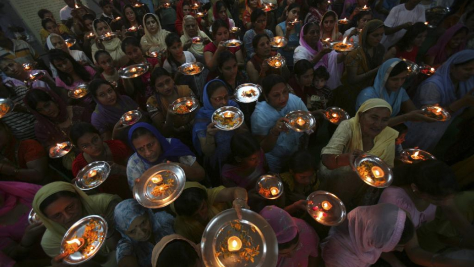 Hindu devotees pray inside a temple in the northern Indian city of Chandigarh, Oct. 8, 2010.