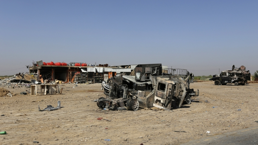 Burnt vehicles belonging to the Iraqi security forces are seen on a road leading to Samarra at Salahuddin province July 12, 2014.