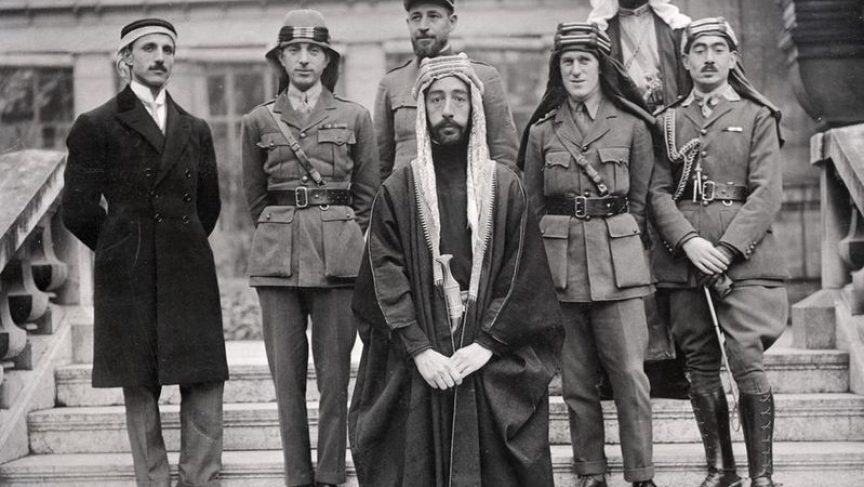 Left to right: Rustum Haidar, Nuri as-Said, Prince Faisal (front), Captain Pisani (rear), T. E. Lawrence, Faisal's slave (name unknown), Captain Hassan Khadri.