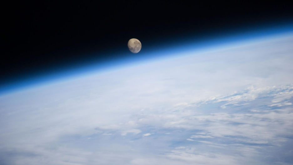 The moonset behind Earth, as viewed from the International Space Station.