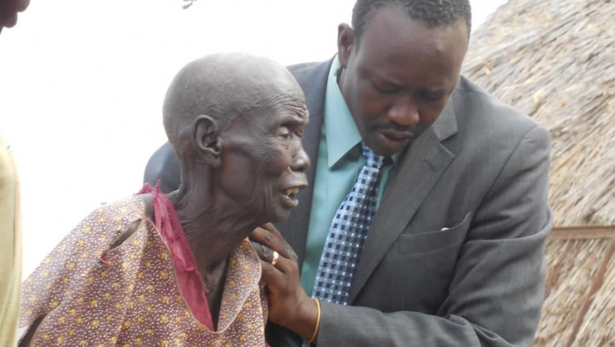 Jacob Atem in 2012 with his step-mother in the village of Maar, South Sudan.