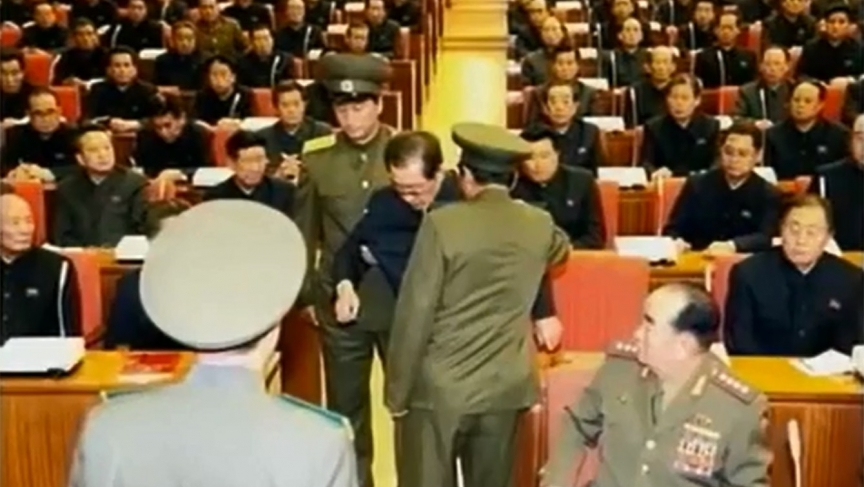 The moment of Jang Song Thaek's arrest, after he was denounced in the middle of a party meeting.