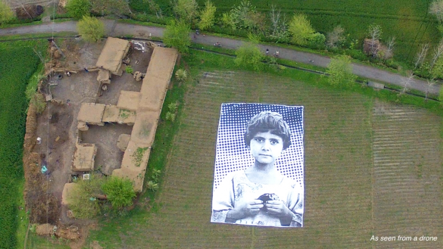 An artist collective erected this photo exhibit in Pakistan to remind drone operators that their targets are real people.