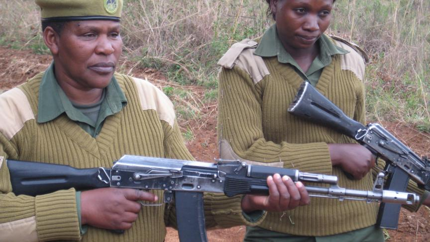 Corporal Patricia Mututu (left), a 30-year Kenya Wildlife Service veteran, and Ranger Mildred Oduor on patrol in Nairobi National Park.  Hundreds of Kenya Wildlife Service rangers have been shot by poachers in the last three years; 13 have been killed.