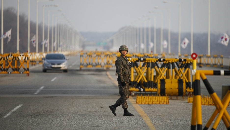 A South Korean soldier patrols at a checkpoint on the Grand Unification Bridge, which leads to the demilitarized zone separating North Korea from South Korea, in Paju, north of Seoul, April 8, 2013.