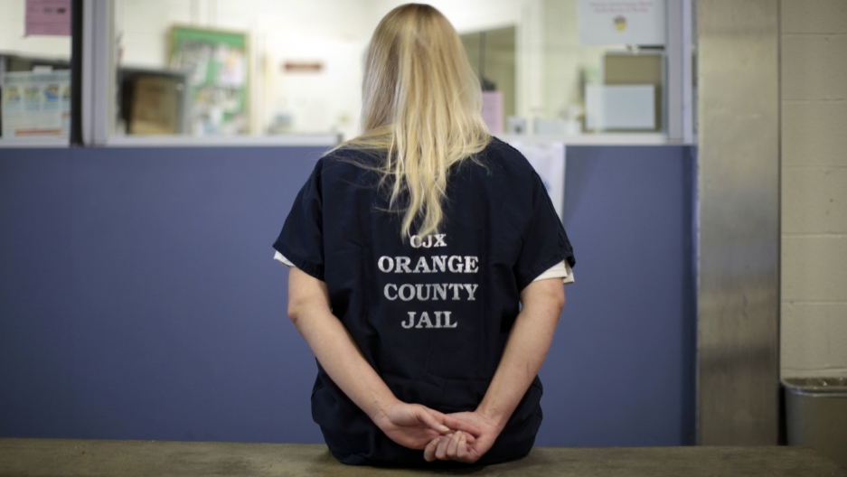 An inmate is checked into the Orange County jail in Santa Ana, California, on May 24, 2011.