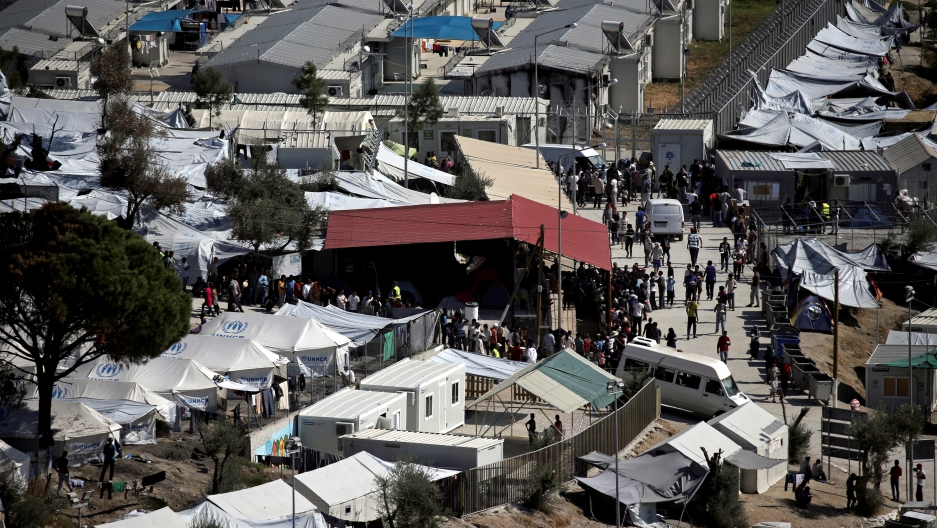 Refugees and migrants line up for food distribution at the Moria migrant camp on the island of Lesbos, Greece October 6, 2016.