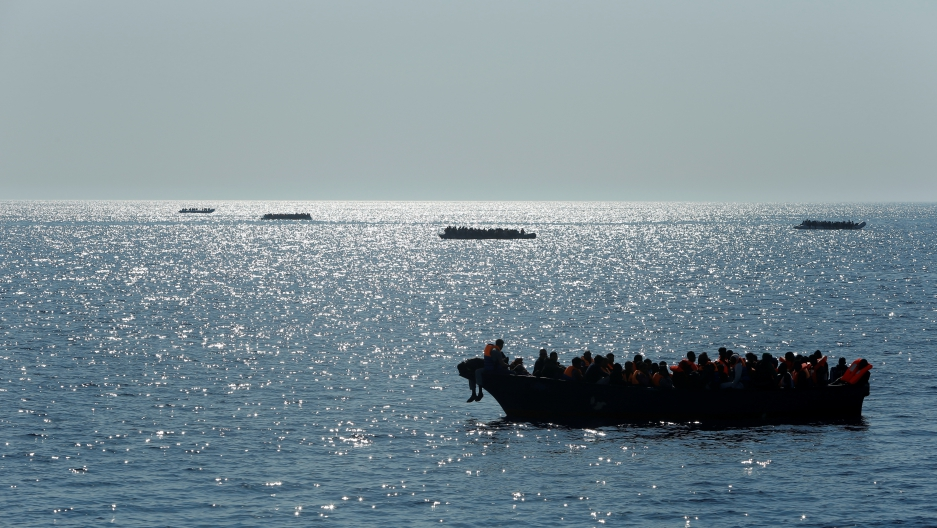 Migrants on wooden boats and rubber dinghies awaiting rescue are seen from the Malta-based NGO Migrant Offshore Aid Station ship Phoenix