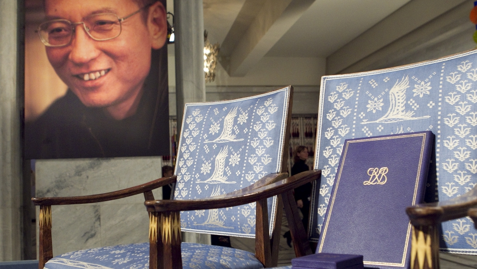 The Nobel certificate and medal is seen on the empty chair where Nobel Peace Prize winner jailed Chinese dissident Liu Xiaobo would have sat