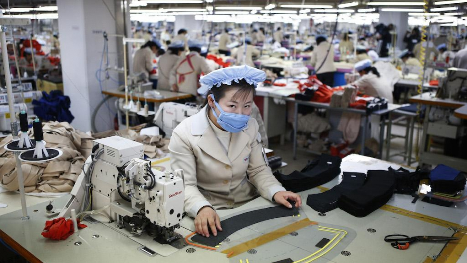 A North Korean at work in the factory of a South Korean company in Kaesong industrial zone inside North Korea, Dec. 19, 2013.