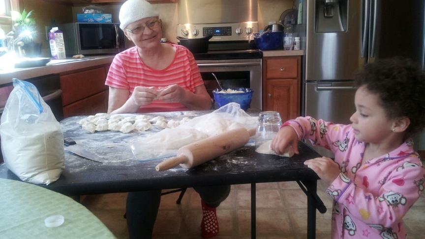Katarzyna Ploszaj's mother, Ela, making pierogies with a young relative