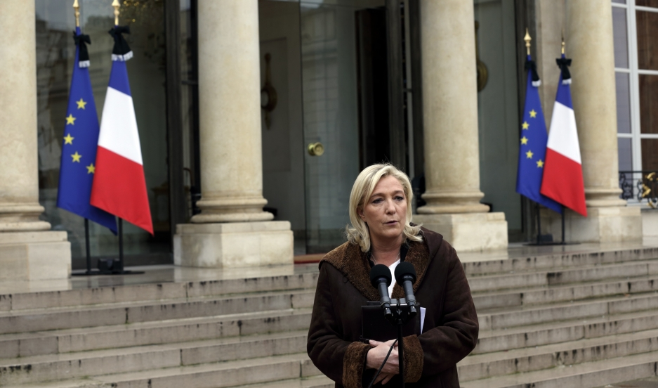 France's far-right National Front political party leader Marine Le Pen speaks to journalists as she leaves after a meeting at the Elyseé palace in Paris on January 9, 2015.