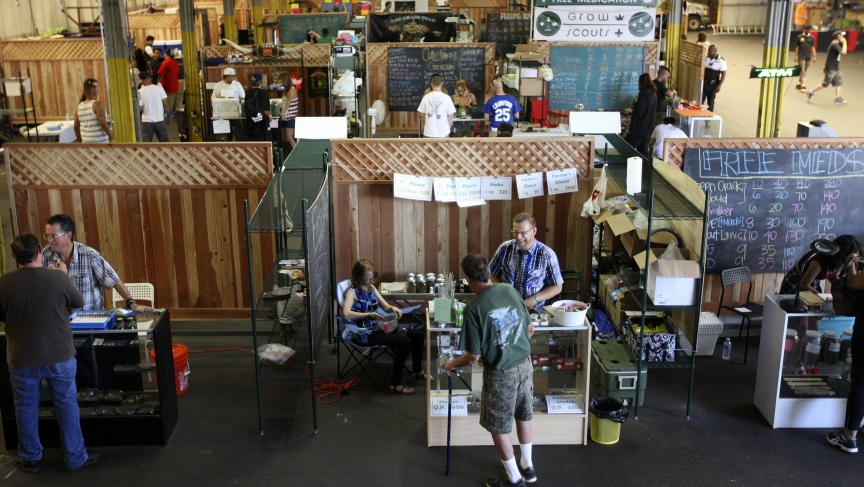 People buy marijuana products at the medical marijuana farmers market at the California Heritage Market in Los Angeles, California July 11, 2014.