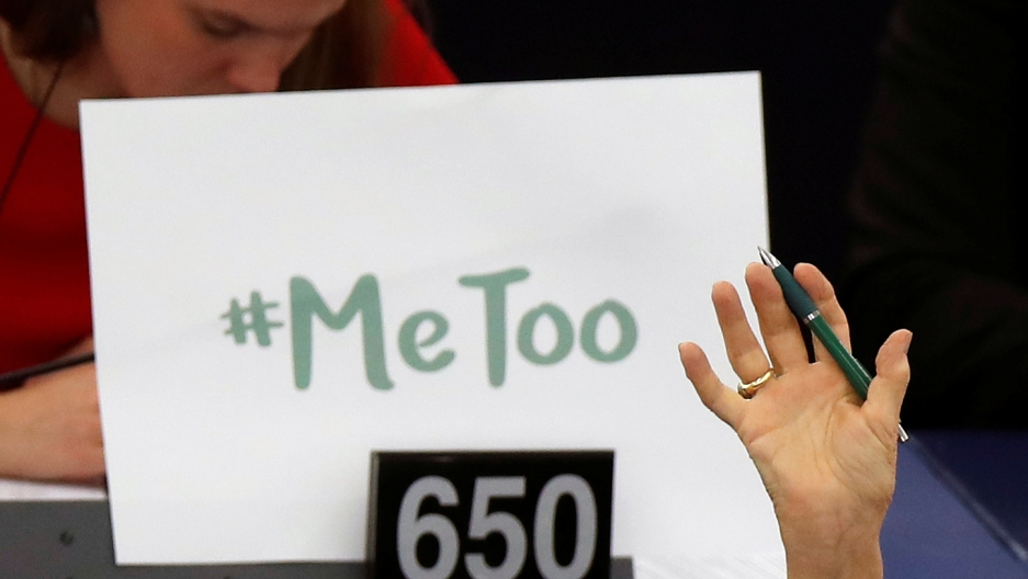 The sign #MeToo is propped up on a European Parliament member's desk during a session to discuss preventive measures against sexual harassment and abuse.