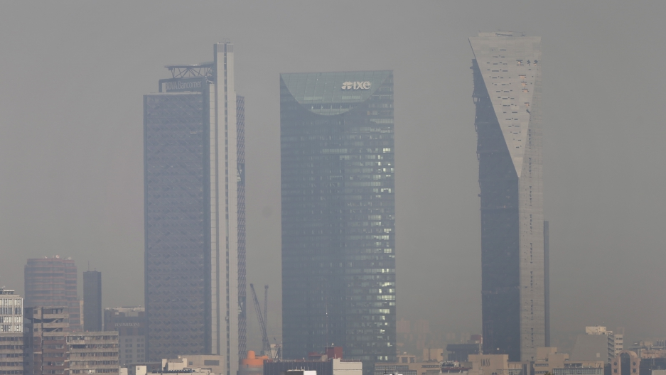 Buildings shrouded in smog in Mexico City