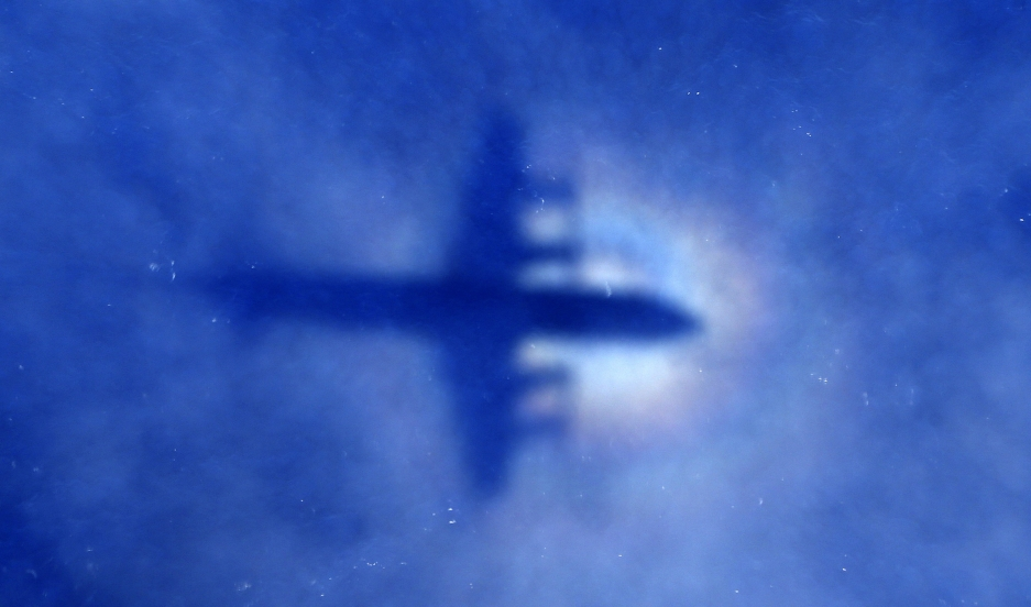 The shadow of a Royal New Zealand Air Force P-3 Orion maritime search aircraft can be seen on low-level clouds as it flies over the southern Indian Ocean looking for missing Malaysian Airlines Flight 370 on March 31, 2014.